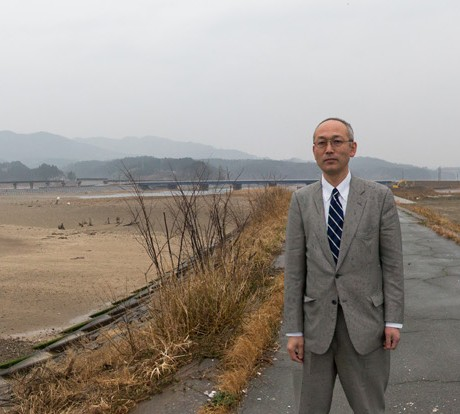2014  - Mr. Abe is a teacher and former resident of Rikuzen Koizumi. He stands where the government proposes to build a giant seawall to prevent future tsunami damage.