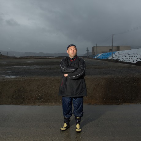 2014 - Mr. Ayukai stands where the debris once covered the earth. Now, it is a barren wasteland destined to one day be a park. No town will be built here again.